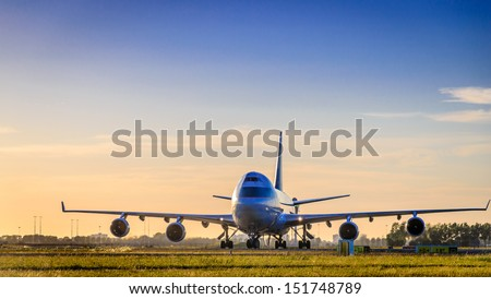 stock-photo-taxing-to-runway-after-landing-151748789.jpg
