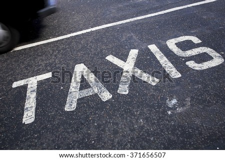 Taxis written on pavement #371656507