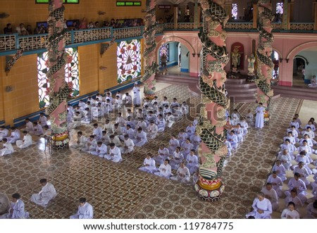 TAY NINH, VETNAM - JULY 26: Religious ceremony in Cao Dai Temple on July 26, 2012 in Tay Ninh, Vietnam. Estimates of the number of Cao Dai adherents in Vietnam to 2 to 3 million.