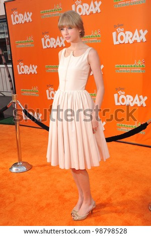 "Taylor Swift at the world premiere of her new animated movie ""Dr. Suess' The Lorax"" at Universal Studios, Hollywood. February 19, 2012  Los Angeles, CA Picture: Paul Smith / Featureflash - stock photo"