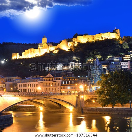 Tbilisi Old Town. Historic district of the capital of Georgia at night against the dark blue sky.