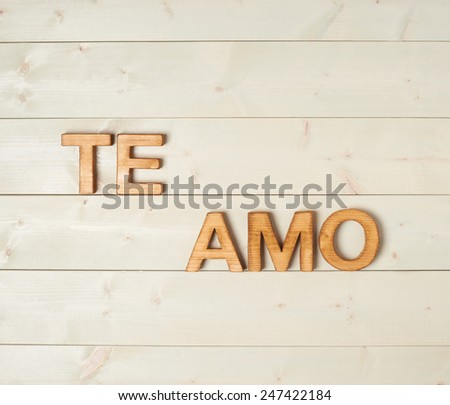 Te Amo meaning I Love You in Spanish written with the block letters over the wooden background Stockfoto ©