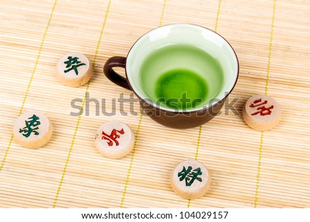 Tea and chinese chess on bamboo tray