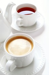 tea and coffee cups with pot
