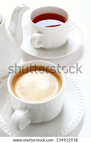 tea and coffee cups with pot - stock photo