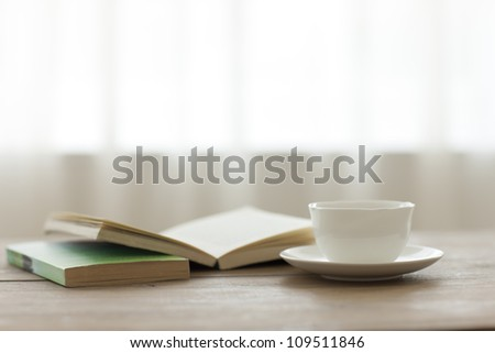 Tea and the book which there is on a table #109511846