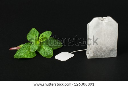 Tea bag and fresh mint black isolated