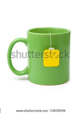 Tea bag in cup isolated on white background