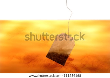 Tea bag in water on the white background