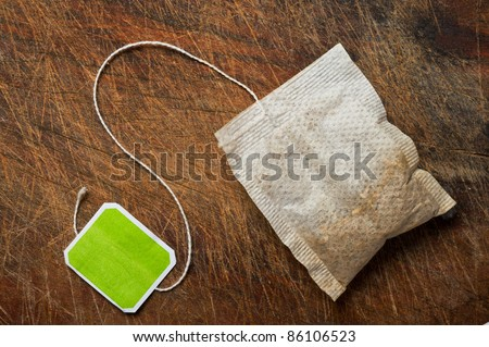 Tea bag on wooden table.