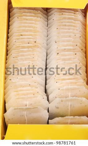 Tea bags with yellow label  tea - stock photo