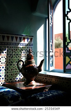 tea-can in a window at marrakesh morocco - stock photo