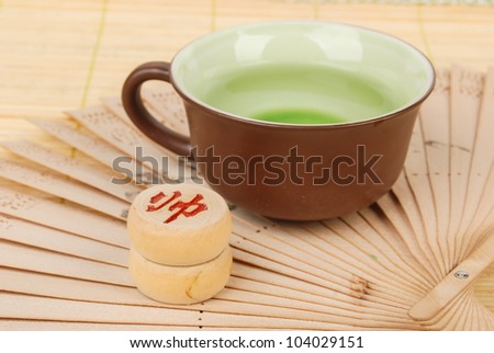 Tea,chinese fan with chess on bamboo tray