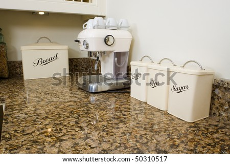 Tea, Coffee And Sugar Pots In A Modern Kitchen Interior With