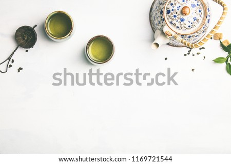 Tea composition on grey background #1169721544