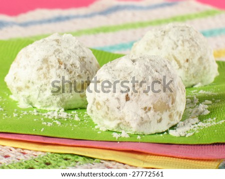 Tea cookies rolled in powdered sugar. Also known as Russian tea cakes and Mexican wedding cookies.