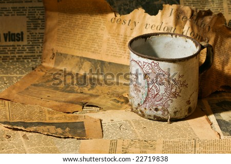 tea cup and old newspaper