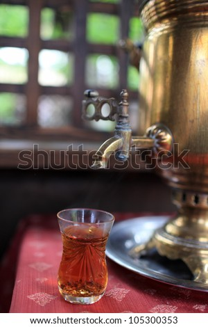 Tea cup and samovar in a russian restaurant