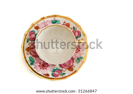 Tea cup and saucer top view isolated