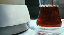 Tea cup of tea next to a kettle or teapot Tea concept
