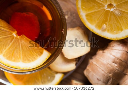 Tea cup with lemon and ginger on the wooden table.