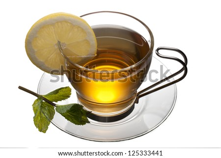 Tea Cup with Lemon and leaves on a saucer in a macro image
