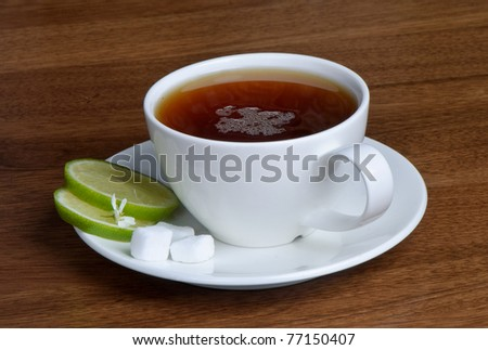 Tea cup with lime and sugar