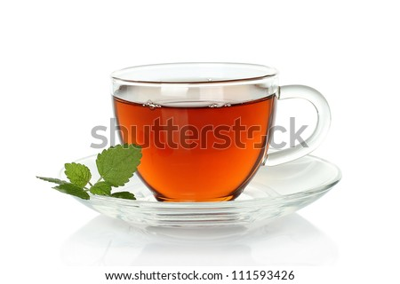 Tea cup with melissa leaves on a white background