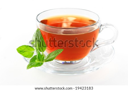 Tea cup with mint leaves on a white background