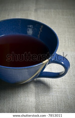 tea cup with red herbal tea