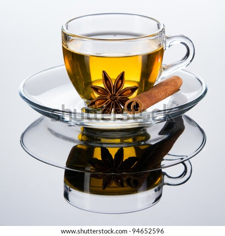 Tea cup with spice, closeup photo on gray background
