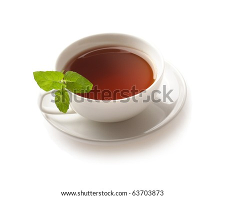 tea cup with tea leaves on white background