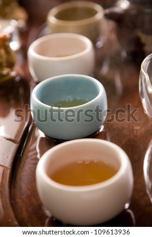 Tea cups on wooden table
