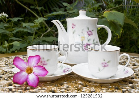 Tea for Two in the Garden with Desert Rose Flower on Golden Deco
