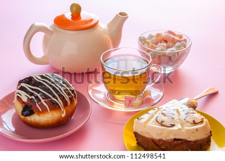 Tea, fresh cherry muffin, colorful delight, cake and doughnut, various sweet dessert