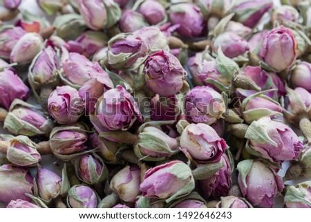 Tea from dried pink rosebuds. Rosebud textured flower background. #1492646243
