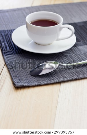 Tea in a white circle on a light table