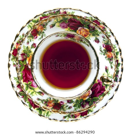Tea in English fine bone china teacup.  Overhead view, isolated on white.