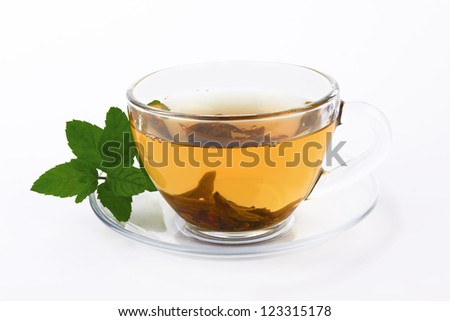 tea in glass cup with mint leaf