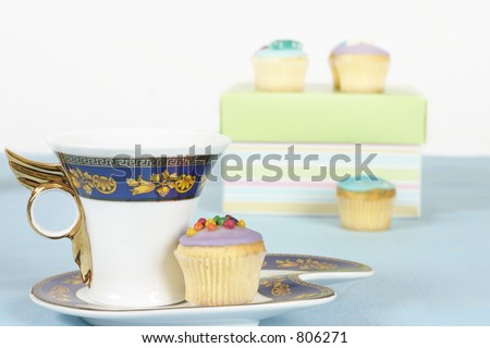 Tea or coffee  and fancy miniature cakes