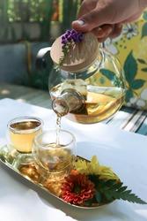 tea or hot tea, pouring tea