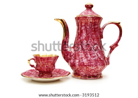 Tea pot and cup isolated on  the white