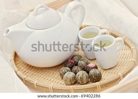tea pot and cup of green tea - tea time