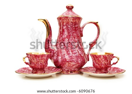 Tea pot and cups isolated on  the white - more similar photos in my portfolio
