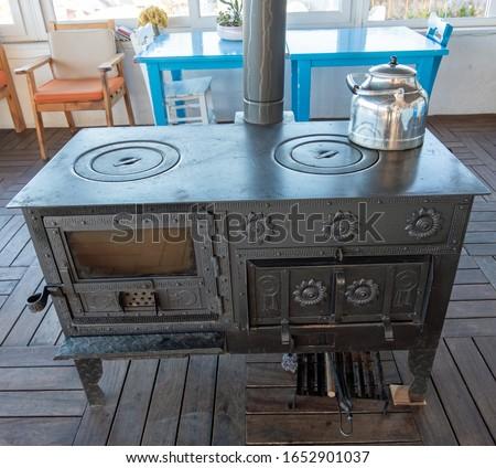 Tea pot on a wood burning kitchen Stove  Stok fotoğraf ©
