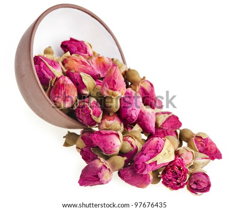 tea rose flowers  on clay cup , isolated on white background