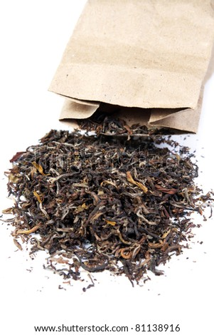 Tea scattered from a package. Isolated on white