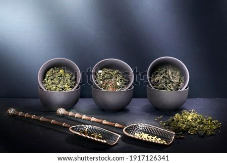 tea set, assorted green, black, fruit teas, pu-erh tea and milk oolong tea, traditional tea drinking with copyspace