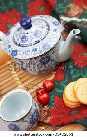 tea set with cookies and cherries