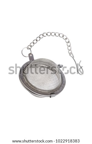 Tea strainer on a chain isolated white background. A tea strainer is a kitchen accessory closeup. - Shutterstock ID 1022918383